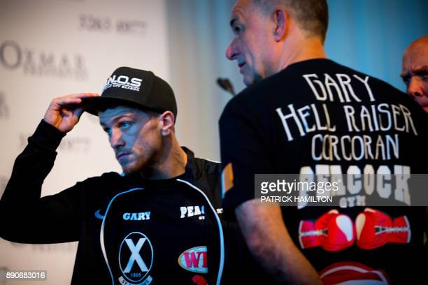 British boxer Gary Corcoran gestures during the prefight weighin at the Brisbane Convention Centre in Brisbane on December 12 the eve of the World...