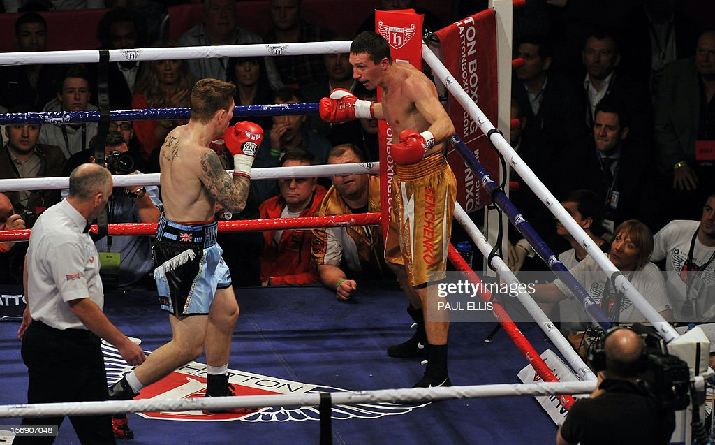 British boxer Ricky Hatton (C) fights Ukranian Vyacheslav Senchenko during the welteweight boxing match at The Manchester Arena in Manchester, north-west England, on November 24, 2012.
