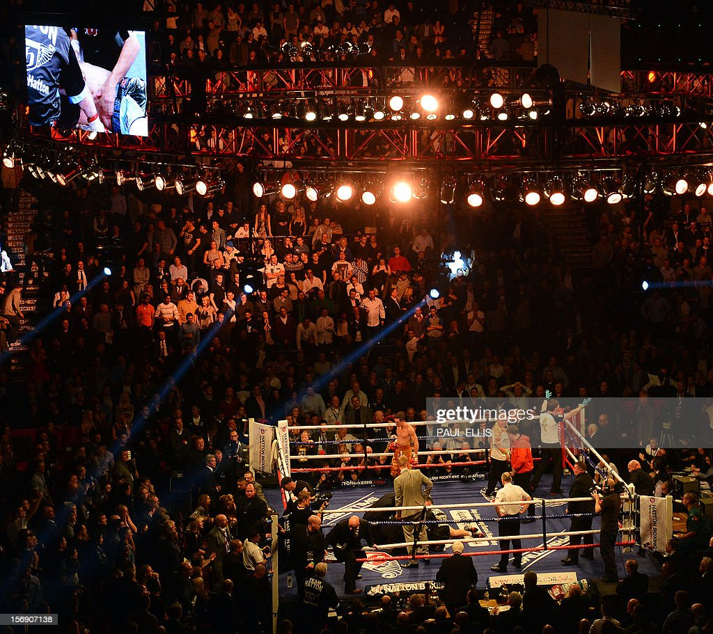 British boxer Ricky Hatton lies in the ring after being beaten by Ukranian Vyacheslav Senchenko in their welterweight boxing match at The Manchester Arena in Manchester, north-west England, on November 24, 2012. AFP PHOTO/PAUL ELLIS