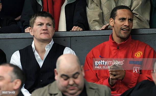 British boxer Ricky Hatton sits with Manchester United's English defender Rio Ferdinand before the English Premier League football match against...
