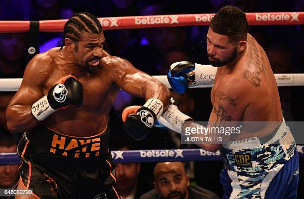 British boxers David Haye and Tony Bellew battle during their heavyweight boxing match at the O2 Arena in London on March 4 2017 Tony Bellew stunned...