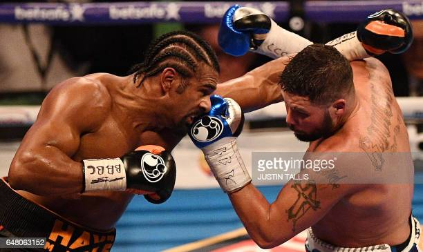 TOPSHOT British boxers David Haye and Tony Bellew exchange blows during their heavyweight boxing match at the O2 arena in London on March 4 2017 Tony...