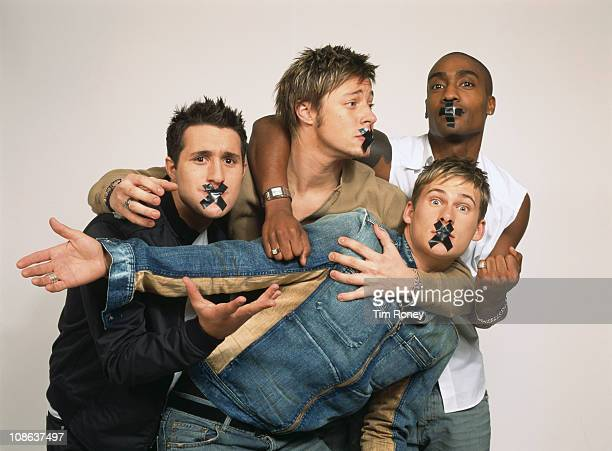 British boy band Blue with their mouths taped shut London circa 2003 They are Simon Webbe Lee Ryan Duncan James and Antony Costa