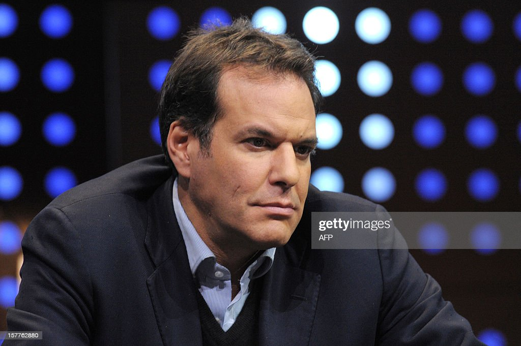 British Brent Hoberman, Co-Founder of PROfounders Capital, Chairman of made.com and Founder and Chairman of mydeco.com listens while taking part in a jury for a Start-Up Competition during LeWeb conference in Saint-Denis, near Paris on December 6, 2012. Le Web is Europe's largest tech conference, bringing together the entrepreneurs, leaders and influencers who shape the future of the internet. AFP PHOTO ERIC PIERMONT
