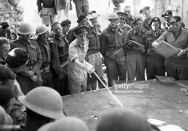 British Brigadier General illustrating to tank commanders the manoeuvres to unlock the fortress of Tobruk Tobruk November 1941