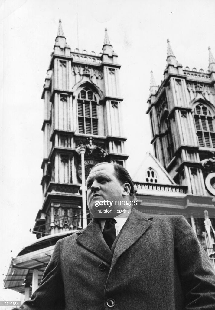 British broadcaster and journalist Richard Dimbleby (1913 - 1965), outside Westminster Abbey, where he commentated on Queen Elizabeth II's coronation. Original Publication: Picture Post - 6535 - Television's Greatest Story - pub. 1953 Original Publication: People Disc - HC0134