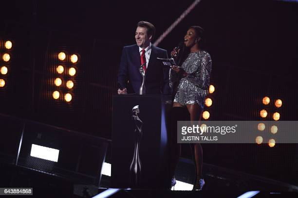 British broadcaster Jonathan Ross and super model Naomi Campbell announce the winner of the BRITs global success award during the BRIT Awards 2017...