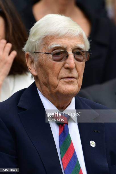 British broadcaster Michael Parkinson sits in the royal box on centre court on the ninth day of the 2016 Wimbledon Championships at The All England...