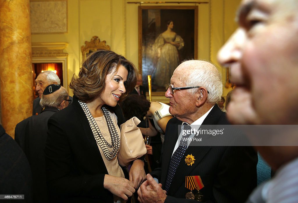 British broadcaster Natasha Kaplinsky (L) speak with guests during a reception for survivors of the Holocaust to commemorate International Holocaust Remembrance Day at 10 Downing Street on January 27, 2014, in London, England. The Prime Minister has announced that actress Helena Bonham Carter, broadcaster Natasha Kaplinsky, chief rabbi Ephraim Mirvis and a selection of politicians and businessmen will sit on the Holocaust Commission, which will discuss ways to ensure future generations will not forget the events of the Holocaust.