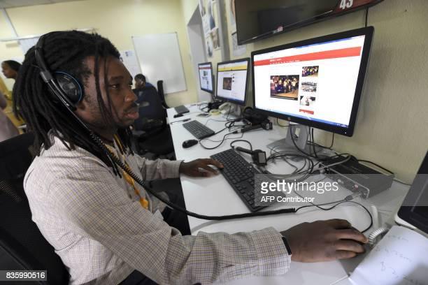 A British Broadcasting Corporation programmer Busayo Iruemiode checks a website in Pidgin in Lagos on August 18 2017 On August 21 2017 the British...