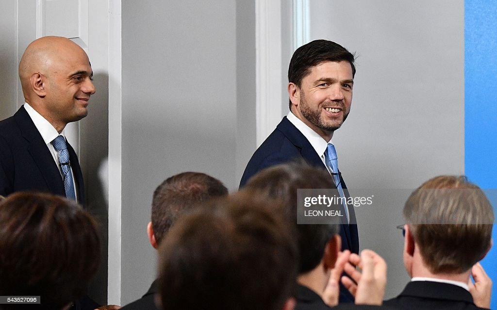 British Business Secretary Sajid Javid (L) smiles as he arrives with British Work and Pensions Secretary and Conservative MP, Stephen Crabb, at a news conference in central London on June 29, 2016, where Crabb announced his candidacy for the leadership of the Conservative Party. British Prime Minister David Cameron's successor will be announced on September 9 after nominations are submitted by June 30 at the latest, the Conservative Party said. Britain has been pitched into uncertainty by the result of the June 23 referendum, with Cameron announcing his resignation, the economy facing a string of shocks and Scotland making a fresh threat to break away. / AFP / LEON