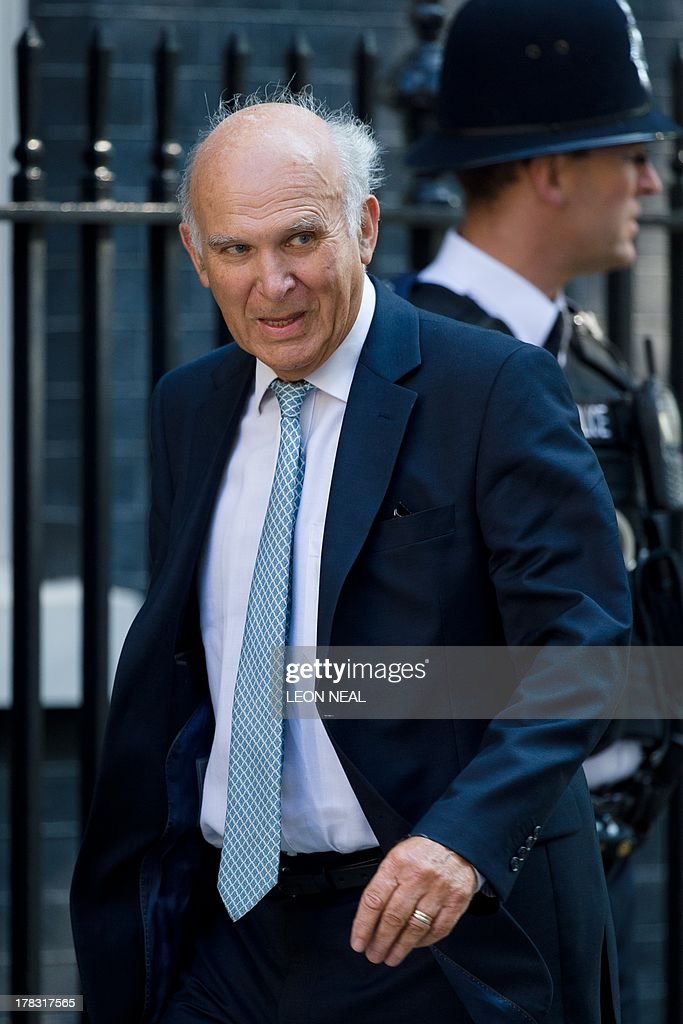 British Business Secretary Vince Cable arrives at 10 Downing Street in central London on August 29, 2013 ahead of a Cabinet meeting to discuss a response to Syria following chemical attacks that Britain believe were launched by the Syrian regime. British lawmakers were on August 29, set to vote on Britain's response to chemical weapons attacks in Syria -- but any military action will require a second parliamentary vote.