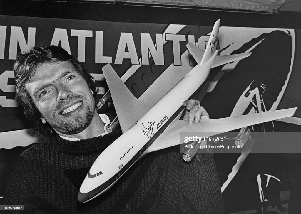 British businessman <a gi-track='captionPersonalityLinkClicked' href=/galleries/search?phrase=Richard+Branson&family=editorial&specificpeople=220198 ng-click='$event.stopPropagation()'>Richard Branson</a> holding a model Boeing 747 at a press conference for the launch of his Virgin Atlantic airline, London, 29th February 1984. Branson has announced his plan for a scheduled service between Gatwick and Newark using a leased 747. The fare is to be 99 pounds.