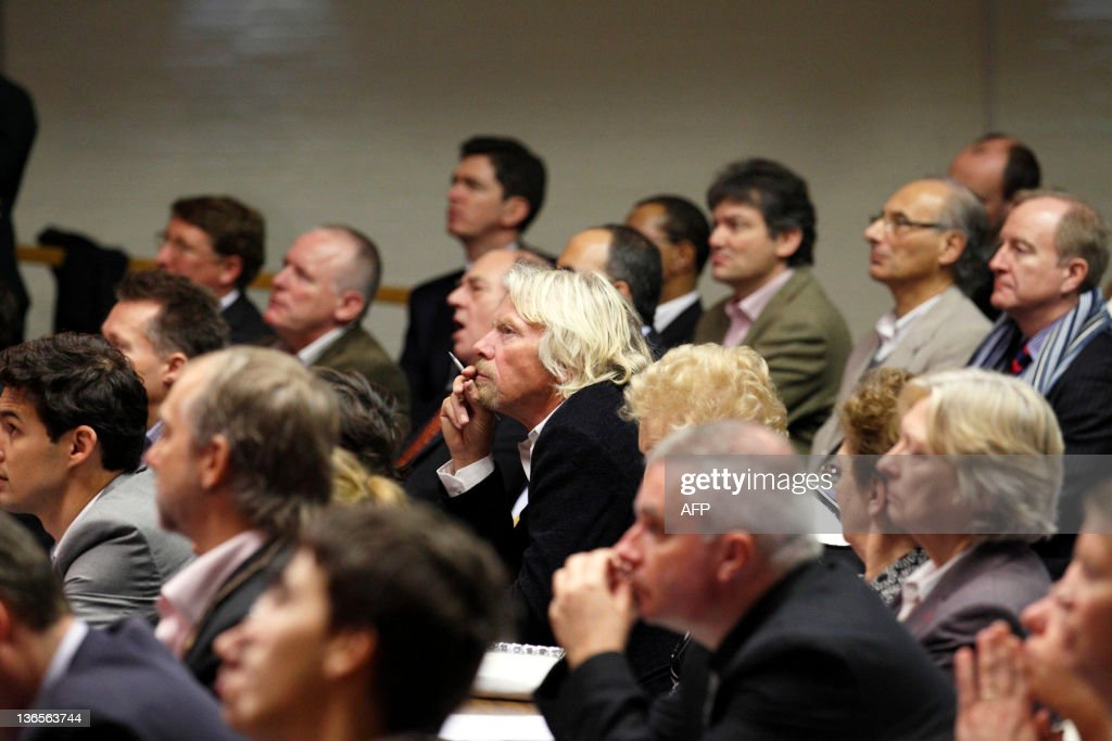British businessman Richard Branson sits in the audience at Stephen Hawking's 70th birthday symposium lecture at The University of Cambridge on January 8, 2012. British scientist Stephen Hawking was forced to miss a scientific debate to mark his 70th birthday Sunday because he was only discharged from hospital two days earlier. AFP PHOTO / JUSTIN TALLIS