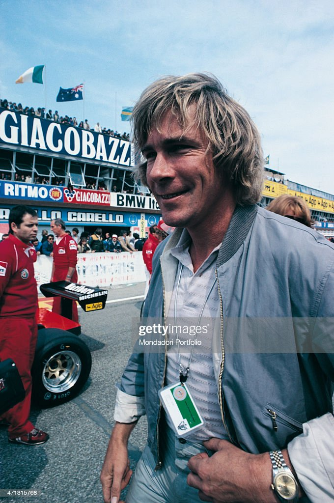 British car racing driver James Hunt smiling on a racetrack 1970s