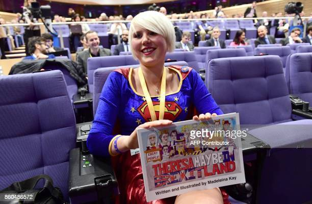 British cartoonist Madeleine Kay an antiBrexit activist wearing a costume of Superwoman speaks to journalists as she tries to attend a press...