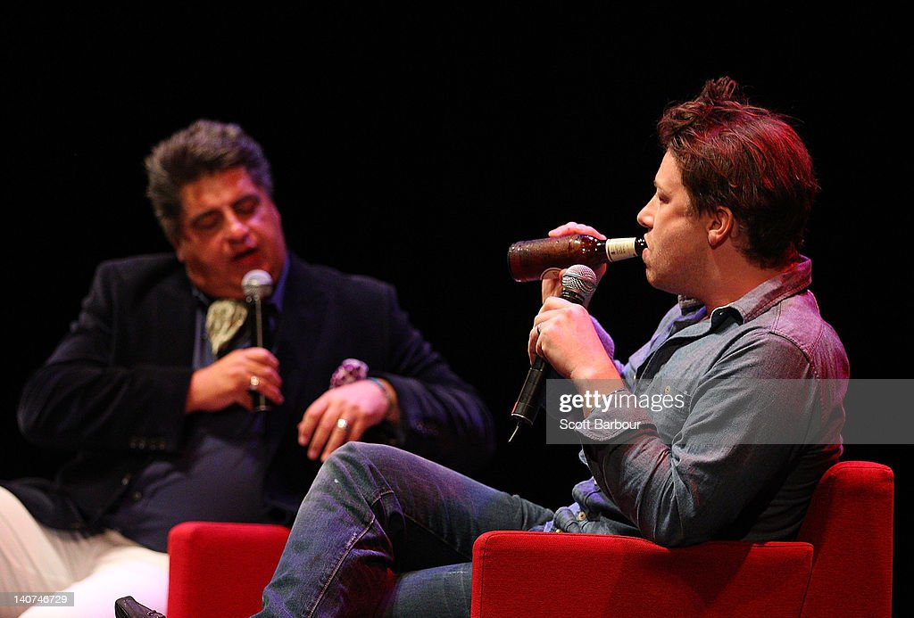 British Celebrity Chef <a gi-track='captionPersonalityLinkClicked' href=/galleries/search?phrase=Jamie+Oliver&family=editorial&specificpeople=159384 ng-click='$event.stopPropagation()'>Jamie Oliver</a> drinks a beer as he speaks with food journalist and television personality Matt Preston and an audience about responsible eating during an engagement at the Wheeler Centre on March 6, 2012 in Melbourne, Australia. The Government and the Good Foundation will pledge together over AUD5 million to bring Oliver's Ministry of Food to the state to help teach cooking techniques and nutrition to participants and help combat obesity as part of the Victorian Healthy Eating Enterprise.