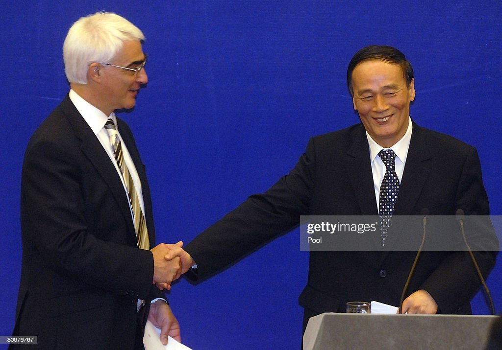 British Chancellor of the Exchequer, Alistair Darling (L) attends a press conference with Chinese Vice Premier Wang Qishan at the Great Hall of the People on April 15, 2008 in Beijing, China. Darling is visiting China for International Economic Dialogue, on codes of conduct for sovereign wealth funds, with the Group of Seven leading industrial nations and the IMF.