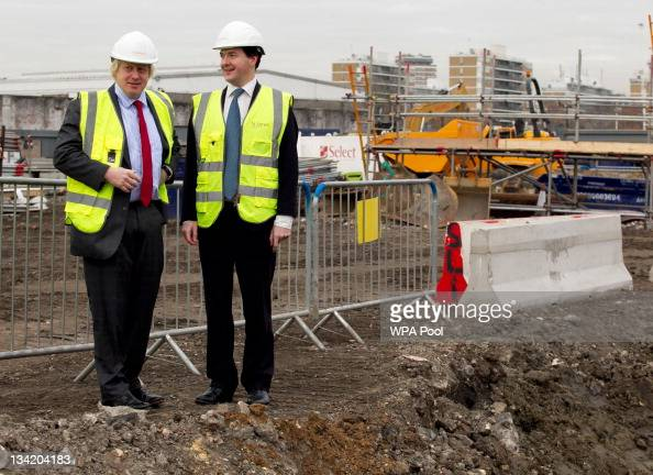 British Chancellor of the Exchequer George Osborne and London Mayor Boris Johnson talk together during their visit to the Riverlight construction...