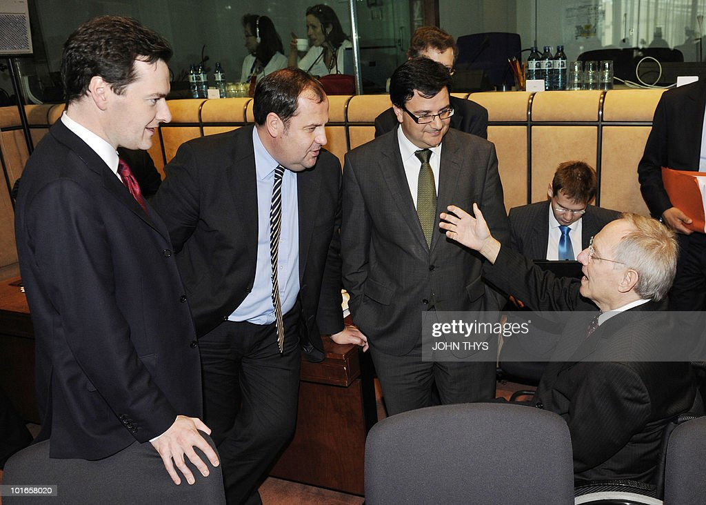 British Chancellor of the Exchequer George Osborne, Austrian Finance Minister Josef Proell and undentified delegate speak with German Finance Minister Wolfgang Schaeuble (R) before a Economy Task Force meeting at the EU headquarters in Brussels on May 21, 2010. European ministers headed for landmark talks on curbing overspending Friday amid global turmoil over the eurozone debt crisis and signs of damage to economic recovery.