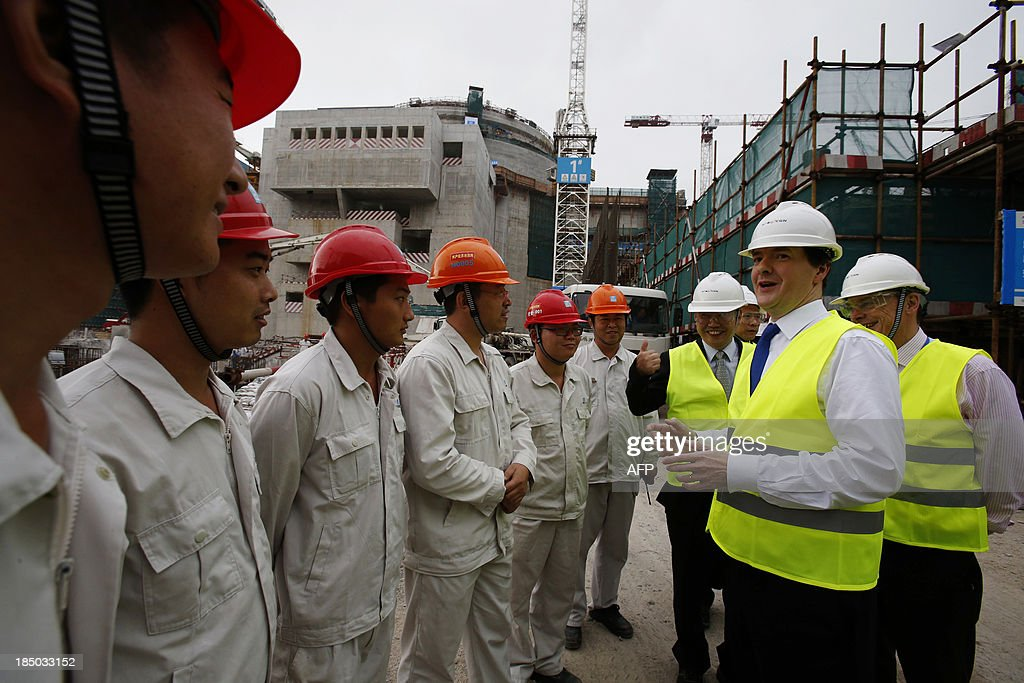 British Chancellor of the Exchequer George Osborne chats with workers beside Taishan Nuclear Power Joint Venture general manager Guo Liming and EDF...