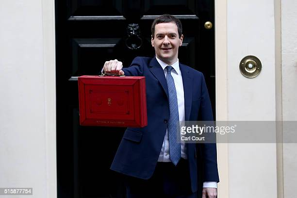 British Chancellor of the Exchequer George Osborne holds up the Budget Box as he poses for photographs outside 11 Downing Street on March 16 2016 in...