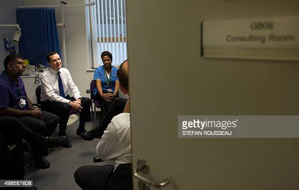 British Chancellor of the Exchequer George Osborne meet doctors and nurses during a visit to Streatham High Practice an NHS doctor's surgery in south...