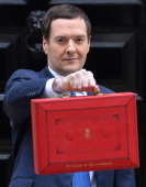 British Chancellor of the Exchequer George Osborne poses for pictures holding the budget box outside 11 Downing Street in London on March 19 as he...
