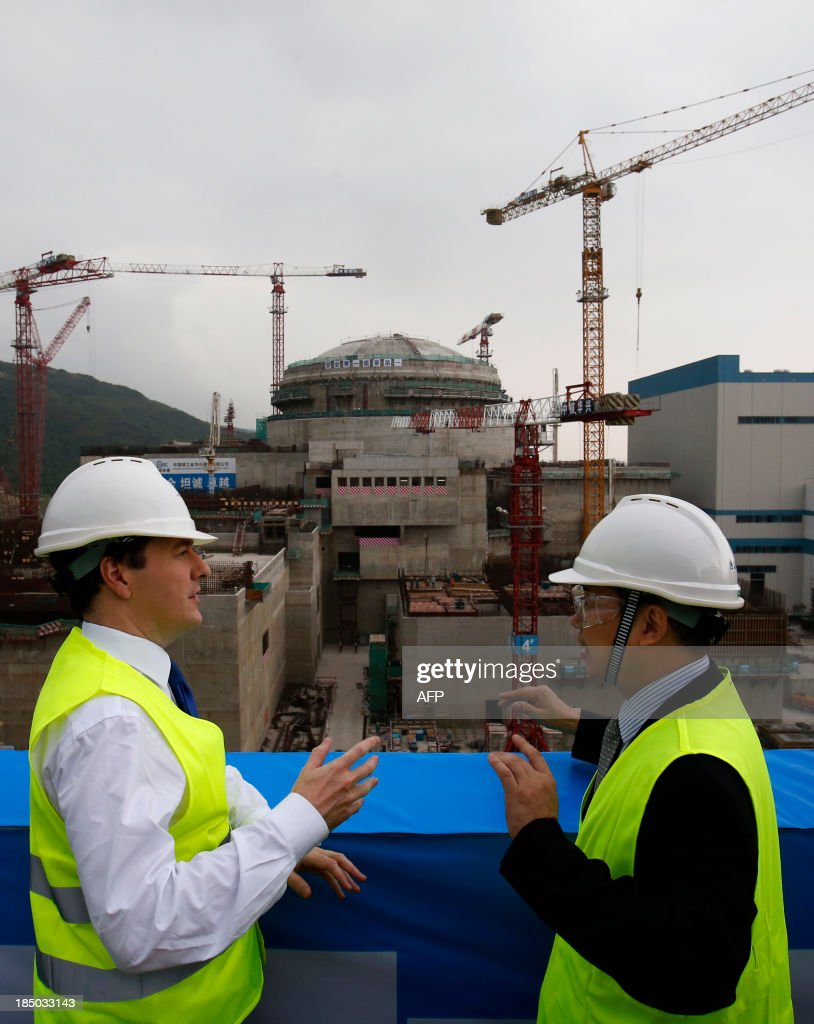 British Chancellor of the Exchequer George Osborne talks with Taishan Nuclear Power Joint Venture general manager Guo Liming in front of a nuclear...