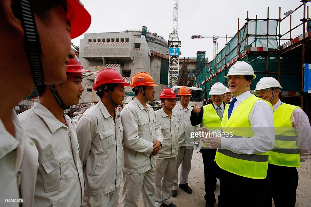 British Chancellor of the Exchequer George Osborne talks with workers as Guo Liming of Taishan Nuclear Power Joint Venture Co Ltd and EDF Energy CEO...