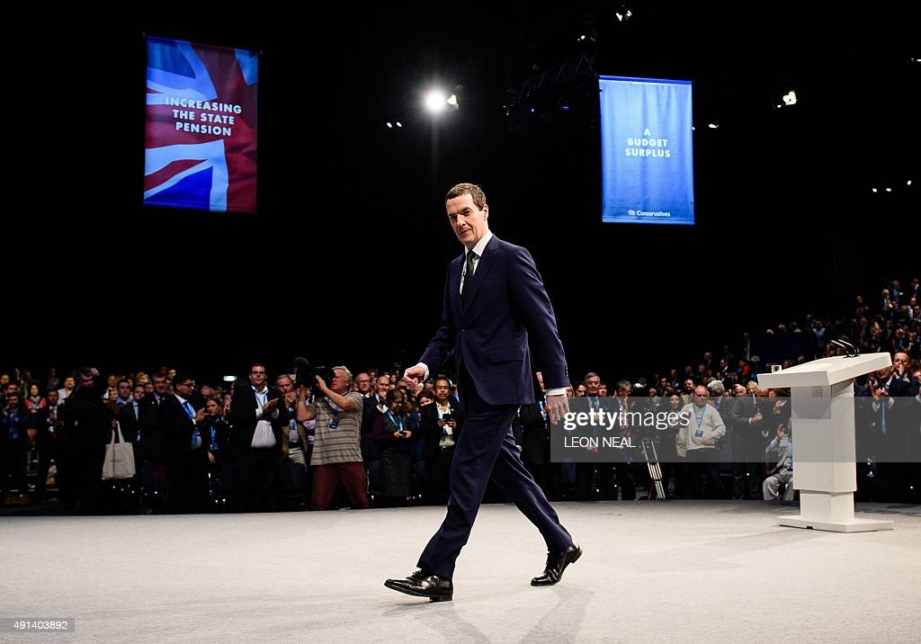 British Chancellor of the Exchequer George Osborne walks from the stage after delivering his keynote address to delegates on the second day of the...