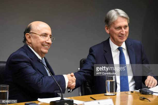 British Chancellor of the Exchequer Philip Hammond and Brazilian Finance Minister Henrique Meirelles shake hands during a press conference in...