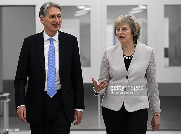 British Chancellor of the Exchequer Philip Hammond and British Prime Minister Theresa May tour engineering and scientific technology company...