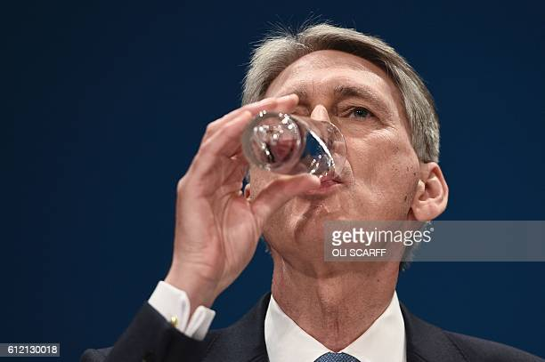 British Chancellor of the Exchequer Philip Hammond makes a keynote address on the second day of the annual Conservative Party conference at the...