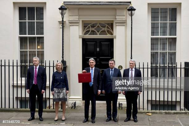 British Chancellor of the Exchequer Philip Hammond poses with the Budget Box as he stands with members of his ministerial team Economic Secretary to...