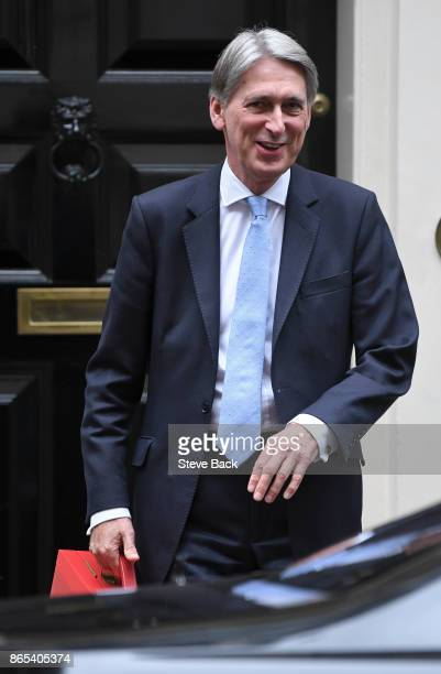 British Chancellor Philip Hammond leaves 11 Downing Street for a Brexit briefing at the House of Commons on October 23 2017 in London England