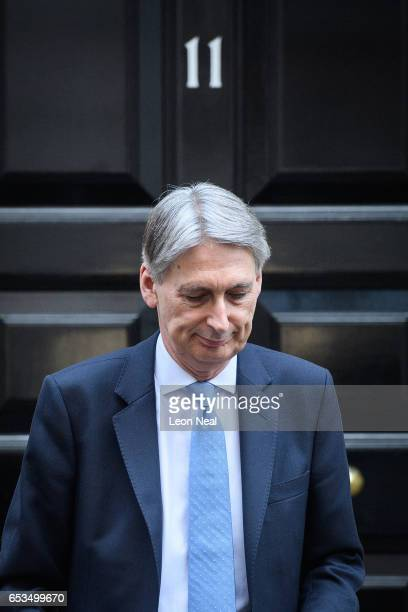 British Chancellor Philip Hammond leaves number 11 Downing Street as he makes his way to the House of Commons on March 15 2017 in London England The...