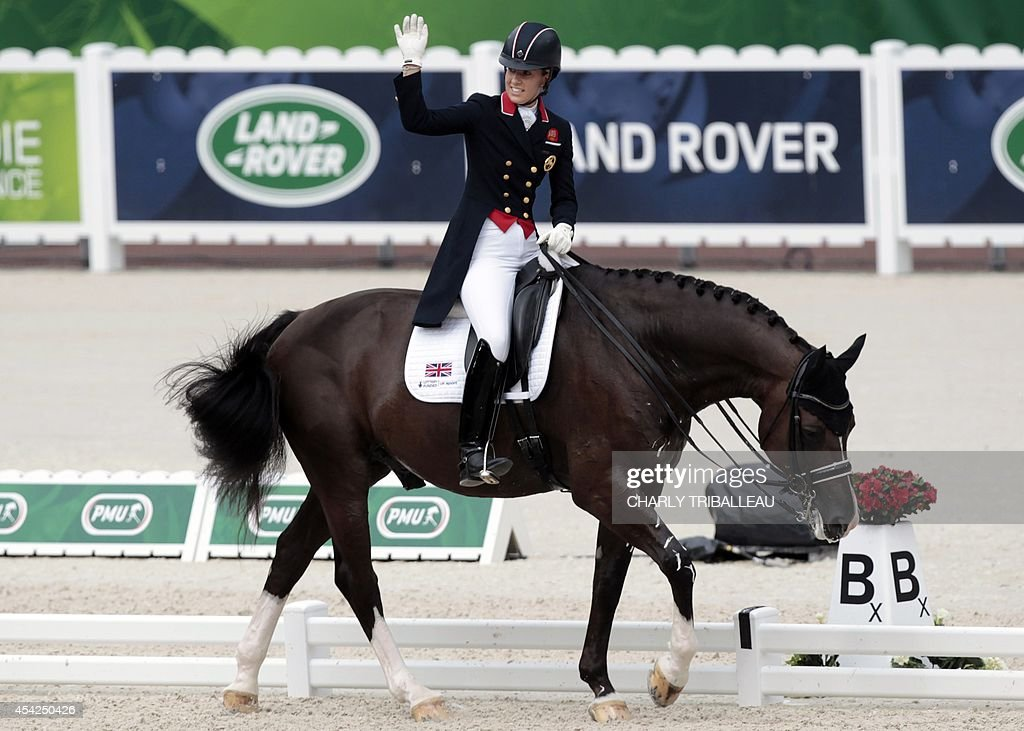 British Charlotte Dujardin waves while riding Valegro on August 27, 2014 during the Individual Dressage Grand Prix of the 2014 FEI World Equestrian Games at D'Ornano Stadium in the northwestern French city of Caen.