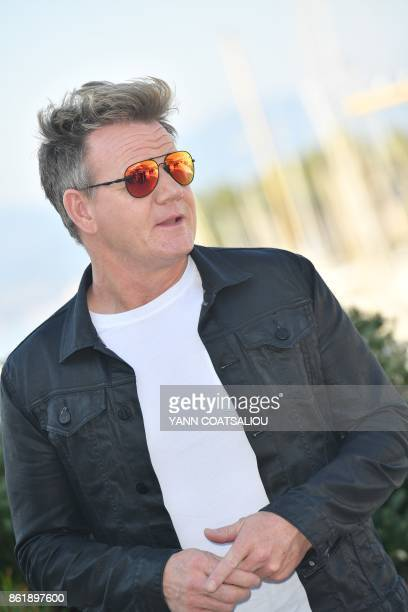 British chef Gordon Ramsay poses during the MIPCOM trade show in Cannes southern France on October 16 2017 / AFP PHOTO / YANN COATSALIOU