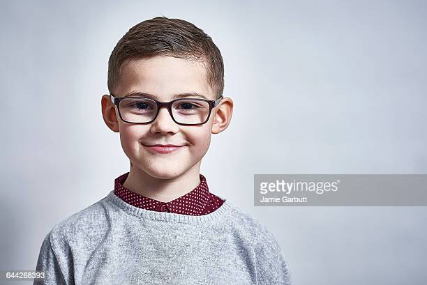 A British child stood smiling proudly