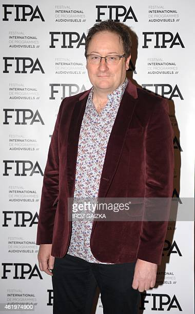 British Chris Chibnall creator of 'Broadchurch' poses after receiving a 'Eurofipa honor' during the Fipa in Biarritz on January 22 2015 AFP PHOTO /...