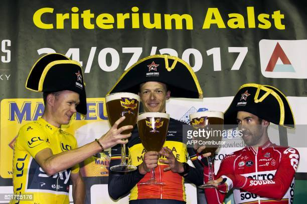British Chris Froome of Team Sky Belgian Oliver Naesen of AG2R La Mondiale and Belgian Thomas De Gendt of Lotto Soudal celebrate on the podium with...