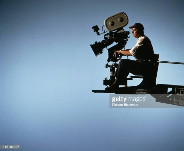 British cinematographer Tony PierceRoberts BSC on a camera crane circa 1990