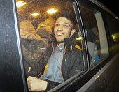 British citizen smiles in a car as he leaves an hospital after they undergo medical check up and fingerprinting in Hatay southern of Turkey on April...