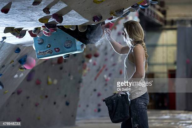 British climber Mina LeslieWujastyk cleans a hold as she trains in 'The Depot' climbing wall ahead of the forthcoming Bouldering World Cup season on...