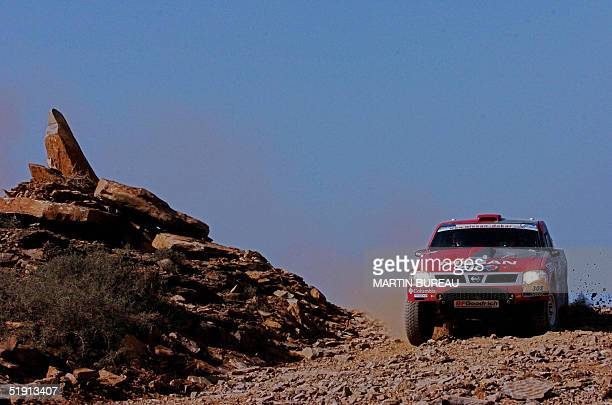 British Colin Mc Rae drives his Nissan 04 January 2005 during the fifth stage of the 27th Dakar Rally between Agadir and Smara McRae driving a Nissan...