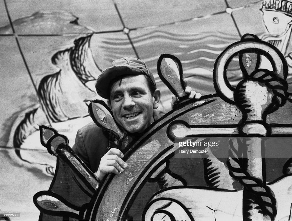 British comedian Norman Wisdom in a pantomime version of 'Robinson Crusoe' at Golders Green, London.