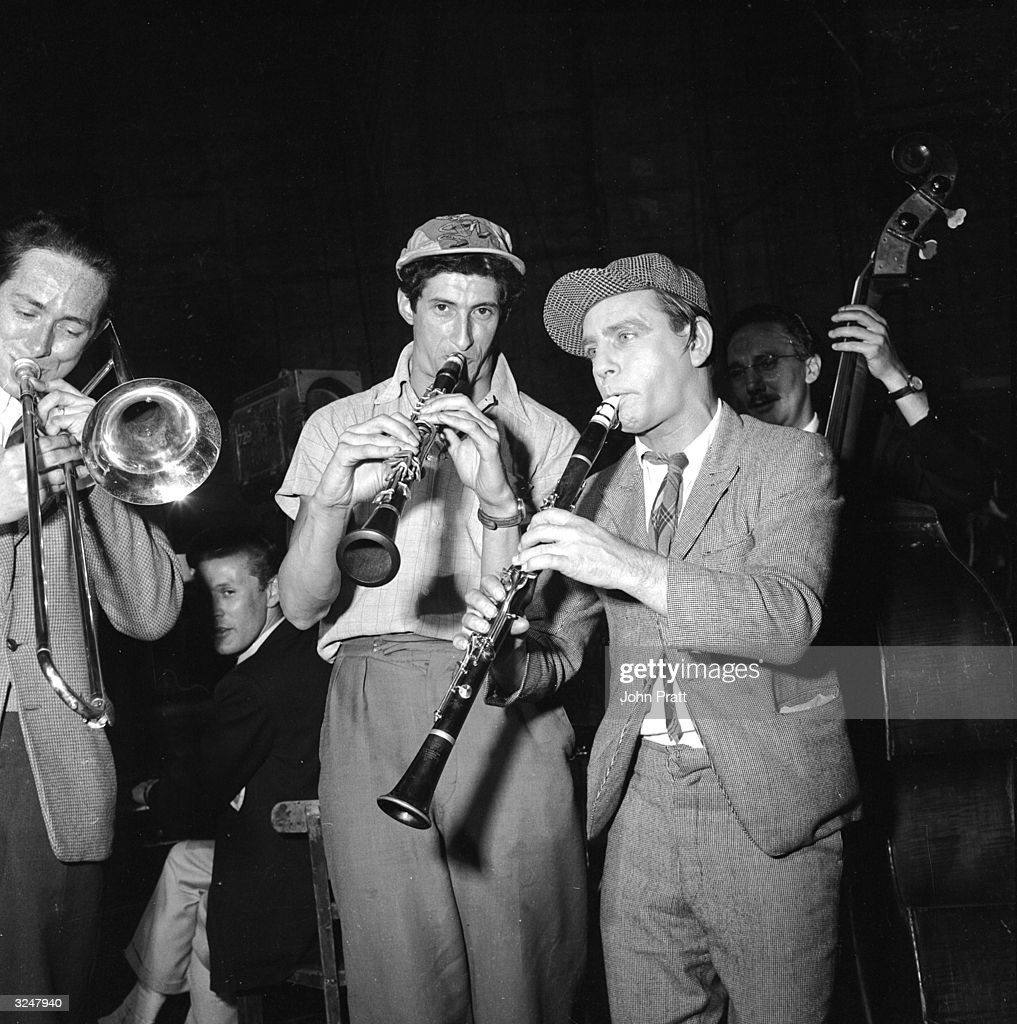 British comedian Norman Wisdom (right) plays clarinet with musician Cy Laurie (1926 - 2002) on the set of 'Just My Luck' at Pinewood Studios.