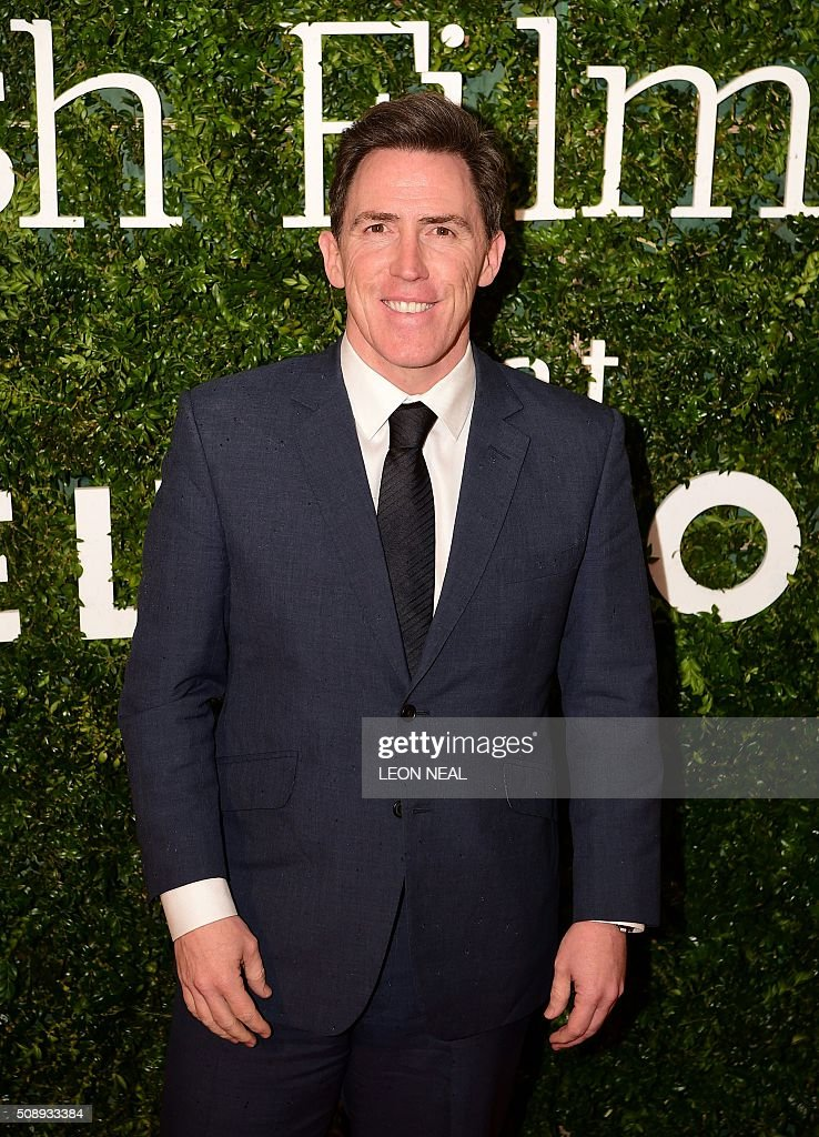 British comedian Rob Brydon poses on arrival for the British film awards in central London on February 7, 2016. / AFP / LEON NEAL