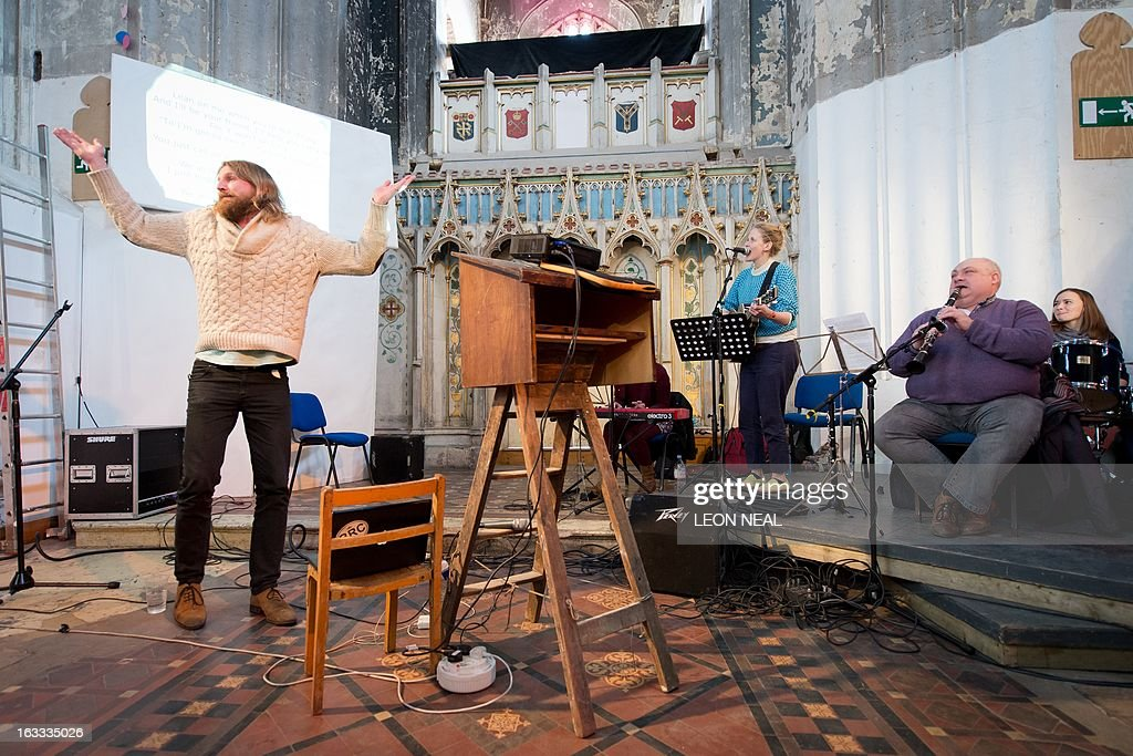 British comedian Sanderson Jones a cofounder of The Sunday Assembly an atheist service held at a converted church leads a service in north London on...